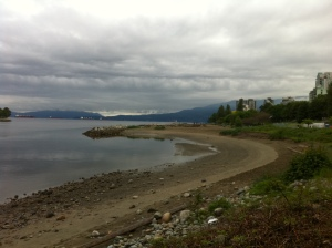 View of the beach and mountains from the seawall at English Bay
