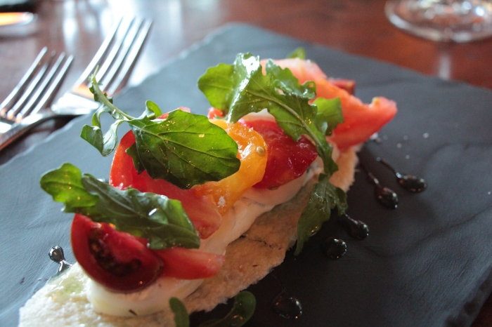 Goat cheese and heirloom tomato tart, by Chef Xavier Lacaze of Briggs Kitchen + Bar