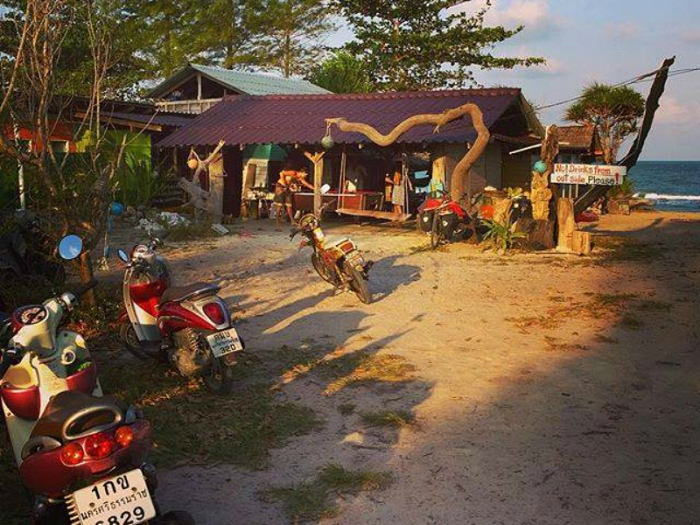 exterior of a beach bar with motorcycles parked out front